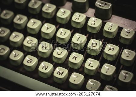 old green typewriter - stock photo