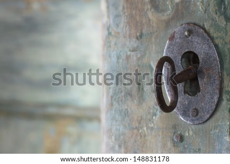 Old green wooden antique door opening with light shining through - stock photo