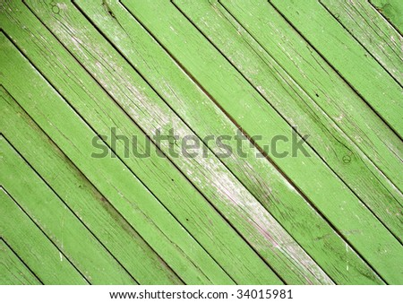 Old green wooden fence background - stock photo