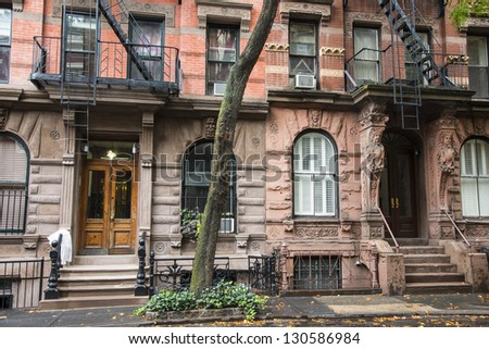 Old Greenwich Village apartment buildings in New York City - stock photo