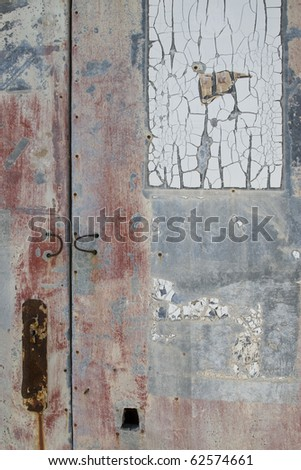 Old grey and red weathered door - stock photo