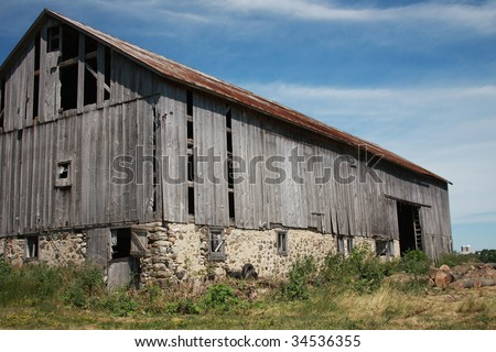 old grey Wisconsin dairy barn - stock photo