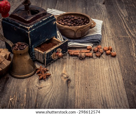 old grinder and coffee beans on a wooden background - stock photo