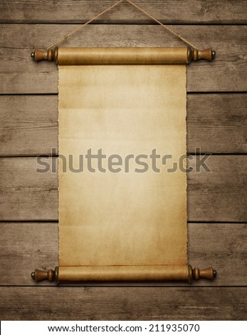 Old grunge blank paper scroll on the wooden wall with copy space - stock photo