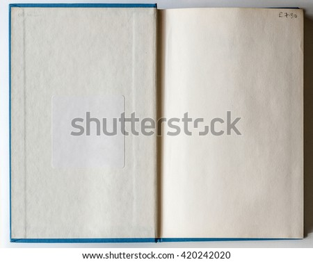 Old grunge book opened to the first page showing aged textured paper inside. - stock photo