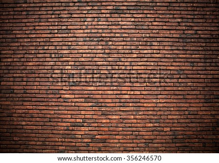 Old grunge brick wall background. - stock photo