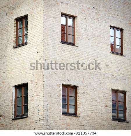old grunge brick wall with six windows background - stock photo