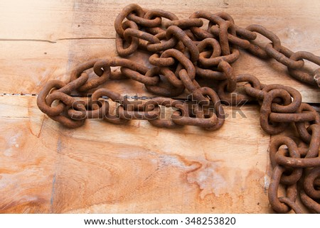 old grunge chain on wood - stock photo