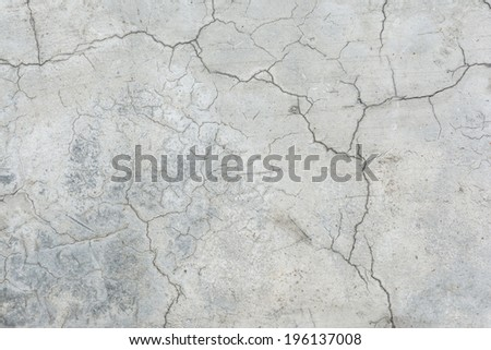 Old grunge crack grey concrete wall texture background. - stock photo