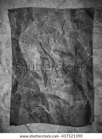 Old grunge crumpled gray paper texture, on concrete texture background, vertical composition - stock photo