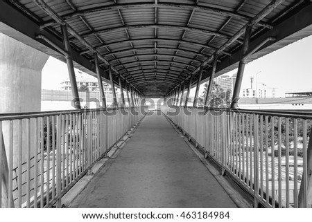 Old grunge foot bridge or overpass in black and white filter for background