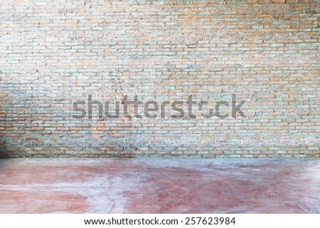 old grunge interior with red brick wall - stock photo