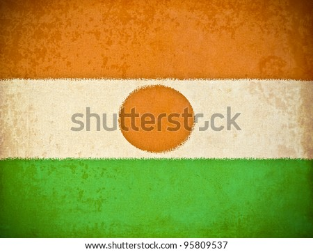 old grunge paper with Niger flag background