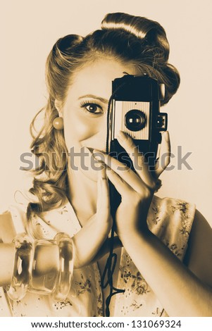 Old Grunge Photograph Of A Female Fashion Photographer Turning Film Camera Vertical To Portrait When Capturing People Images - stock photo