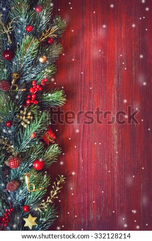 Old grunge red wooden board with Christmas border and copy space for text. Christmas card.