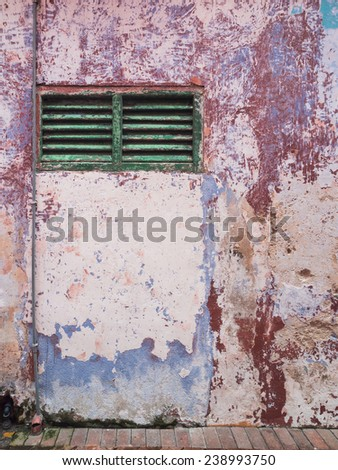 Old grunge ventilation grill. Textured old wall with swollen paint. - stock photo