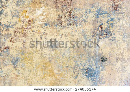 old grunge wall of an old house with remainings of color - stock photo