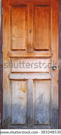 Old grunge wood simple door - stock photo