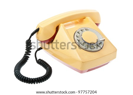 Old grunge yellow with red telephone. Isolated on white background. - stock photo
