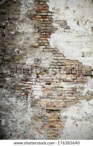 Old grungy brick wall with cracks - stock photo
