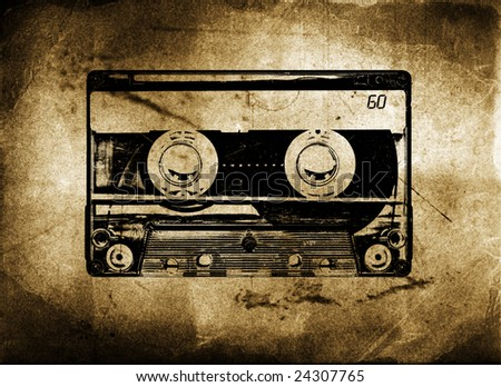 Old Grungy cassette tape with grunge and aged textured background - stock photo