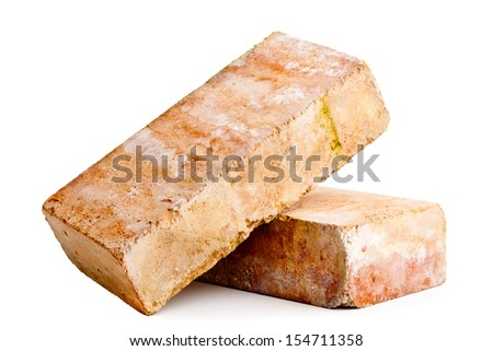 Old grungy clay bricks stacked on white background - stock photo
