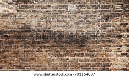 Old grungy dark brick wall, background photo texture