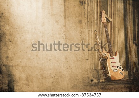 old grungy sax with electric guitar in retro look - stock photo