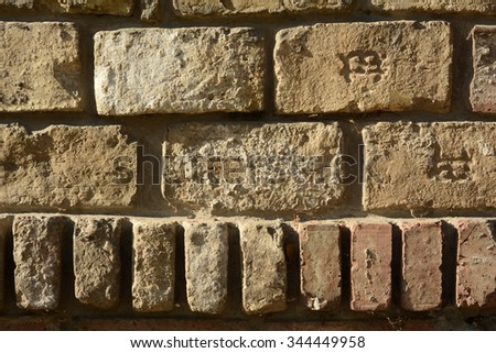 Old grungy wall from bricks - stock photo