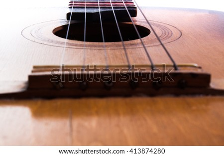 Old guitar on a white background. Classical Guitar