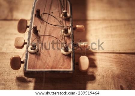 old guitar on grunge vintage wood - stock photo