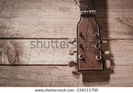 old guitar with vintage style - stock photo