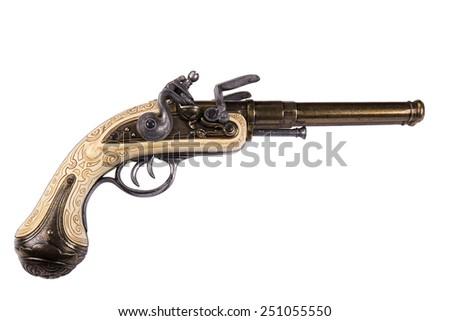Old gun isolated on white - stock photo