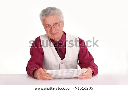 old guy with newspaper at table on white