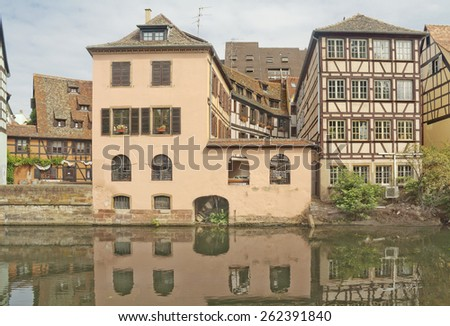 Old half-timbered houses on the river bank in Strasbourg, France - stock photo