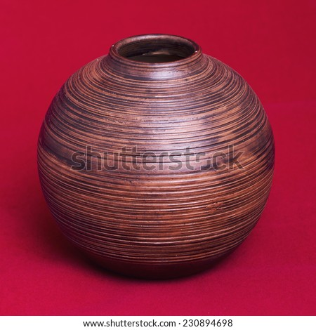 old Hand made Wooden Vase on a red background. - stock photo
