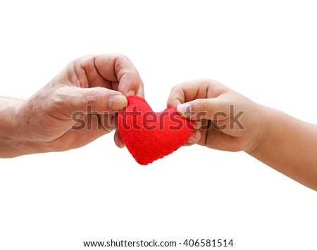 old hand of the elderly and a young hand of a baby holding a red heart together isolated - stock photo