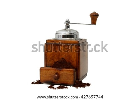 Old hand operated cofee grinder with ground coffee - stock photo