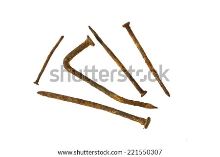 Old handforged rusty nails isolated on white with natural shadows.