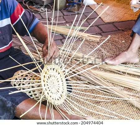 Old hands manually weaving - stock photo