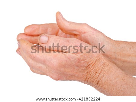 Old hands of the elderly woman begging isolated on white background.
