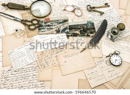 old handwritten french letters and postcards, vintage office accessories. nostalgic paper background - stock photo
