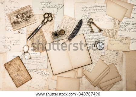 Old handwritten letters, Christmas picture and antique writing accessories. Nostalgic sentimental paper background - stock photo