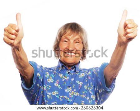 Old happy woman showing ok sign on a white background - stock photo
