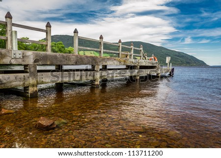 Old harbor over Loch Ness in Scotland - stock photo