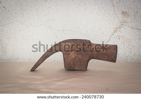 old head nail claw hammer with rust still life on concrete background - stock photo