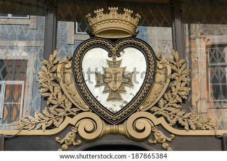 Old heart shape coat of arms - stock photo
