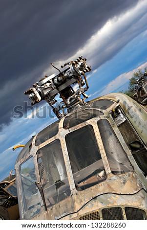 Old helicopters rust in a junkyard near Tuscon Arizona - stock photo