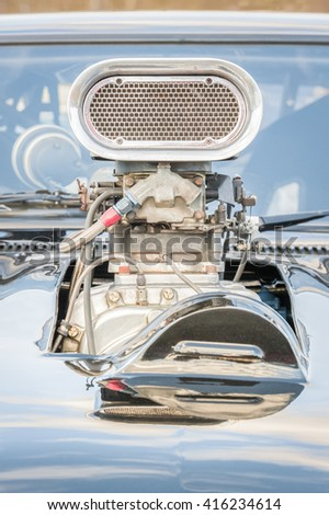 old high-performance  supercharged vehicle engine closeup - stock photo