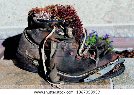 stock-photo-old-hiking-boot-used-for-gar